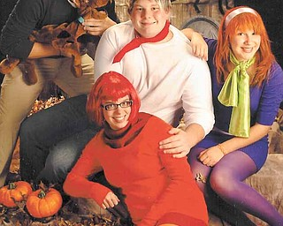 From top left, clockwise, Kyle Forward, Kevin Koncsol, Katelyn Lawrence and Maria Thompson dressed up as characters from the cartoon 'Scooby-Doo' for a costume contest Saturday at the Phantoms hockey game.