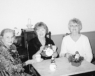 Eagerly awaiting guests for an upcoming tradition in Austintown are hostesses/committee members, from left, Rae Jeanne Mollica, Marge Goldner, and Joyce Pogany. Christmas High Tea, sponsored by the Austintown Historical Society, will be served Nov. 14 at Austintown's National Historic Landmark, the Strock Stone House, 7171 Mahoning Ave. The public is invited, but reservations are a must and need to be made before Sunday. Seatings will be at noon, 2 p.m. and 4 p.m. The cost is $14 per person; $7 for children under 12. The menu includes coffees and a variety of teas, finger sandwiches, scones, pastries and extras that are served during a traditional High Tea. Bone china cups, saucers and dessert plates will complement the lace tablecloths. Free tours of the house will be conducted after each seating. Also included will be a basket raffle. All proceeds will benefit the historical society. Make checks payable to Austintown Historical Society and mail to 1181 S. Raccoon Road, Austintown, OH 44515.