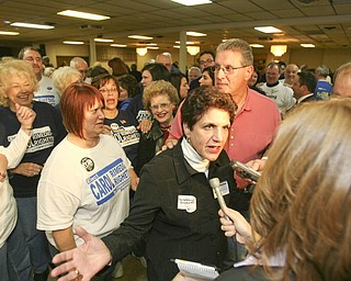 ROBERT  K.  YOSAY  | THE VINDICATOR --..Carol Rimedio Righetti with her husband and a group of suporters celebrate her win at the ITAM club on Meridian Rd.The November election had many incumbents and levies pass.... -30-..(AP Photo/The Vindicator, Robert K. Yosay)