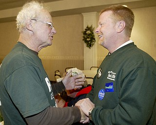 William D Lewis The Vindicator Sean OBien, right talks with supporter Mke Sullivan of Lordstown during a Trumbull Dem party at Enzo'a in Warren Tuesday.