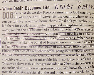 Geoffrey Hauschild|The Vindicator.6.25.2010.Underlines bring attention to a reading about water baptism to be referenced during the water baptism of two OVTC graduates at Youngstown Christian Assembly.