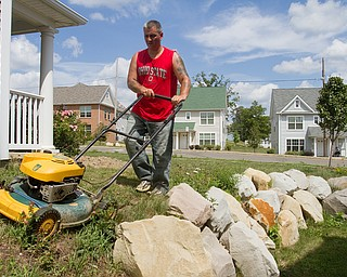 Geoffrey Hauschild|The VIndicator.7.26.2010.OVTC student, Johnathan Anderson, mows grass at Arlington Heights.