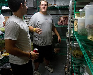 Geoffrey Hauschild|The Vindicator.OVTC students Michael Pinkerman and Bryan Druschel work in the center's walk-in cooler for an upcoming catering event.
