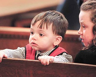 Matthew Metz 1, and sister Katie Metz, 8, of Kinsman watch adoption proceedings with parents Jason and Catherine Metz.