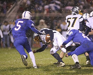 ROBERT K. YOSAY | THE VINDICATOR..Fighting for every yard is McDonald #15 Miles Dunlap as #21 Reserve  Ed Newhouse and #5 John  Rosati  during first quarter action.. McDonald @ Western Reserve - first round .Ó--30-..