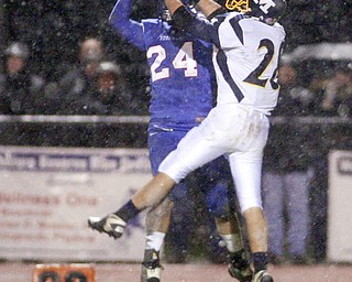 ROBERT K. YOSAY | THE VINDICATOR..Broken play as McDonalds #28 Stephen Mohamed  is blocked by #24 Reserve Thomas Benyo - during first quarter action.. McDonald @ Western Reserve - first round .Ó--30-..