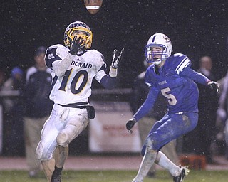 ROBERT K. YOSAY | THE VINDICATOR..Easy Catch as McDonalds #10 Justin Rota pulls in a pass just out of reach of Reserves #5 John Rosati for a first down during second quarter action. McDonald @ Western Reserve - first round .Ó--30-..