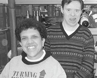 Special individuals with developmental disabilities have been given the opportunity to gain community experience by working in area stores, unloading boxes and getting merchandise ready for shoppers. Among those enjoying the opportunity to work in such shops as T.J. Maxx in Boardman are, from left, Nicole and David, who are sponsored by No Limits and Ginnetti Center in Campbell. No Limits is the day habilitation program for Turning Point Residential Inc., an agency that provides not only day programing but also supported living in small residential settings.