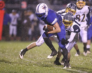 ROBERT K. YOSAY | THE VINDICATOR..Reserves #1 Ryley Sheptock  breaks for a first down as McDonalds #13 Mike Helco tries to bring him down - he does finally. McDonald @ Western Reserve - first round .Ó--30-..