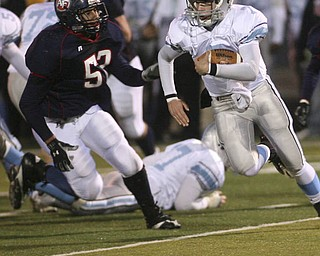 ROBERT  K.  YOSAY  | THE VINDICATOR --..Hot Pursuit as  fitchs #52   Steve Zaborsky  as he closes in on the Rebels QB #7  Ray Russ  First round of playoffs as Willoughby South Rebel at Austintown Fitch Falcons  ... -30-..(AP Photo/The Vindicator, Robert K. Yosay)
