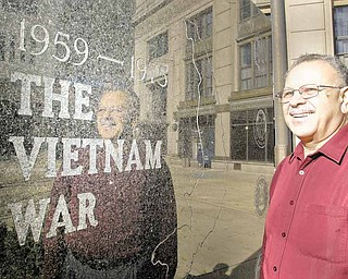 Philip Gonzalez, a Vietnam War Marine veteran, visits the war memorial in downtown Youngstown. Gonzalez received the Purple Heart for an injury suffered during the Battle of Hue.