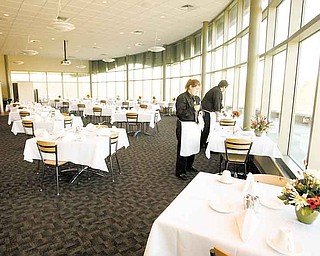Students set tables in The Bistro's dining room. The restaurant at the Mahoning County Career and Technical Center opened to school personnel last week for a practice run.