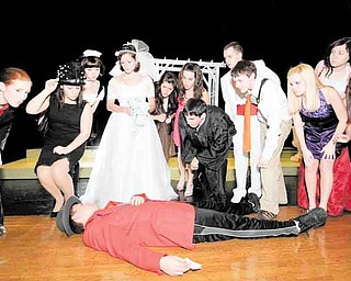 """Cast members react to the apparent death of a wedding guest during a dress rehearsal of """"Bruce and Tina's Wedding"""" Tuesday. The play is the first interactive murder mystery performed at Canfield High School."""