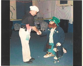 Bill Maine of Boardman has won more than $7,000 over the past 15 years he's been dressing up as a leprechaun. He said he passes out gold-covered chocolate coins to the ladies, who usually think he's a kid dressed up because he doesn't talk while in costume. Maines, who submitted this photo, is 75.