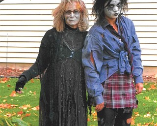 Dee and Lily Hockenberry of Boardman hang together as mother and daughter zombies.
