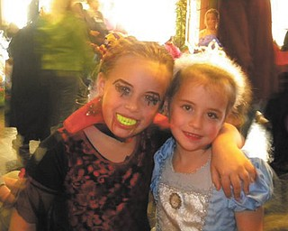 Friends Madalyn Smith and Anna Leshinsky of Boardman are ready for a howling good Halloween party. Photo sent in by Patty Hoover.