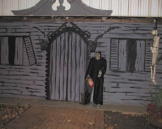 A gruesome greeter awaits visitors at Jason Burgermyer's annual haunted house in Cortland. Photo sent in by Barb Bradford.