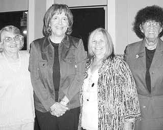 Headed in new direction: As she headed for retirement after serving as executive director for Trumbull County Children Services Board from 1975 to 2010, Marcia Tiger was honored by fellow workers, friends and family members during a party recently at the Hippodrome in Warren. Among the well-wishers who shared the bittersweet moment with Tiger, second from left, are her coworkers from Children Services, from left, Carole Menelle, E. Carol Maxwell and Shelby McElravy.