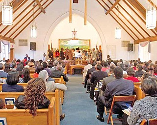 Geoffrey Hauschild|The Vindicator.A service at Holy Trinity Missionary Baptist Church on Sunday afternoon. The church on Youngstown's South Side is celebrating its 60th anniversary.  The church on Youngstown's South Side is celebrating its 60th anniversary.