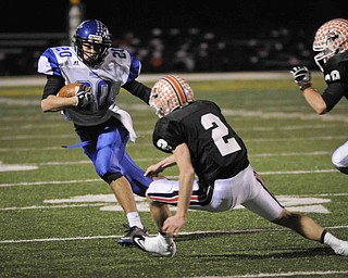Lakeview's Louie Novakovich runs the ball  against Chagrin Fall's Spencer Diedrich, 2,  during their game at Arura on friday night. Photo/Mark Stahl
