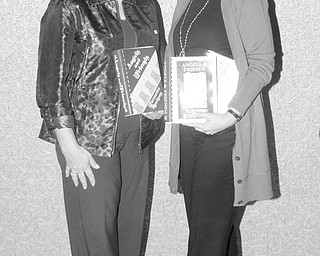 Nick Mays | Special to The Vindicator: Displaying the cookbooks that will provide recipes for foods and baked goods to be featured at the Holiday Brunch and Sweet Shoppe to be sponsored by the Angels of Easter Seals are Joan Zarlenga, left, and Phyllis Bacon, co-chairwomen for the event.