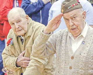 William D LEwis The Vindicator  WWII vets Michael Kopanic, 92, left, and Allen Wolkoff, 91, during singing of the national anthem during a veterans day program at Liberty HS Thursday. Both are of Liberty and were with a group of Liberty vets honored.