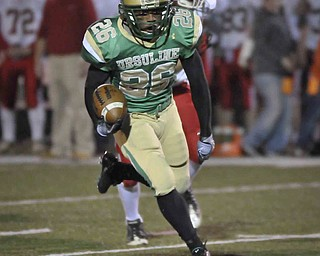 Ursuline's Akise Teague runs the ball against Norwayne during their game at Green on Saturday night. Photo/Mark Stahl