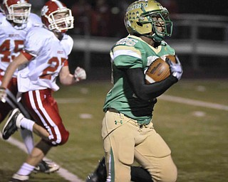 Ursuline's Akise Teague runs for a 1st half TD the against Norwayne during their game at Green on Saturday night. Photo/Mark Stahl
