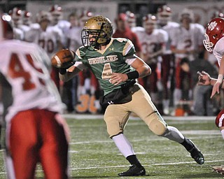 Ursuline QB Paul Kempe,4,  set sto deliver the ball to a teammate against Norwayne during their game at Green on Saturday night. Photo/mark Stahl