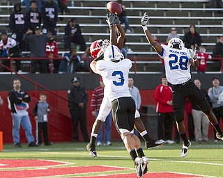 Geoffrey Hauschild The Vindicator.YSU's Dominique Barnes (29) is unable to come up with the ball while receving double coverage from Indiana State's Alex Sewall (3) and Jonny Towalid (28) during the next to last play of the game during the fourth quarter of a game at YSU's Stambaugh Stadium on Saturday afternoon. The final play of the game resulted in an overthrown pass to Barnes in the endzone.