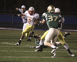 PLAYOFF - (2) Charlie Brown looks to follow his blocking Saturday night. - Special to The Vindicator/Nick Mays