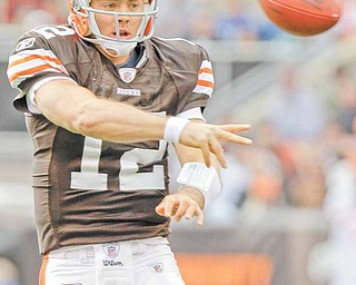 Cleveland Browns quarterback Colt McCoy throws a short pass during the first quarter of an NFL football game against the New York Jets, Sunday, Nov. 14, 2010, in Cleveland. (AP Photo/Mark Duncan)