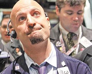 Trader Steven Marcus, left, works on the floor of the New York Stock Exchange. (AP Photo/Richard Drew)