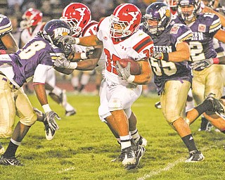 YSU tailback Jamaine Cook tries to avoid the pursuit of WIU linebacker Anthony D'Astice during the first half of the Penguins' game at Western Illinois. Cook had 72 yards on 17 carries in the first half.