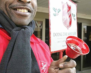 With a smile to go along with his Salvation Army bell, Demetric Brown of Youngstown rings for money in front of the downtown post office on Walnut Street as part of the SA's Red Kettle Campaign.
