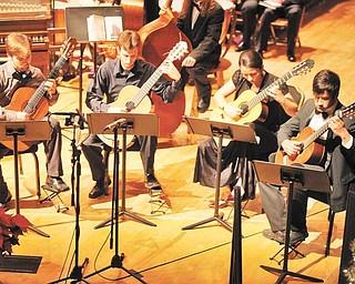 The Dana Guitar Ensemble participates in the annual Dana Holiday Concert, scheduled for Dec. 1 at Stambaugh Auditorium.