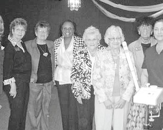 Well-represented: The semiannual meeting of Trumbull County Federation of Women's Clubs began at 9 a.m. Oct. 26 at McMenamy's Banquet Center in Niles. Representatives from the 20 clubs in the federation were present for the brunch, luncheon and programs. Lori Hatzialexiou of Divia's Designs of Hair and Nails gave each woman a sample of lavender face cream and gave two women facial massages. Audrey Schinkel provided musical entertainment. Lined up to thank Hatzialexiou, at right, for her presentation are club officers, from left, Hattie Hawkins, president; Eddie Wolcott, trustee; Sandy Young, corresponding secretary; Myrdis Ledbetter, recording secretary; Ann Schweinfurth, trustee; Sally Bidlack, treasurer; and Shelby McElravy, vice president.