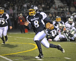 McDonald QB Matthias Tayala runs for the 1st TD of the game against Mogadore during their Div VI playoff game at Twinsburg on Friday night. Photo/Mark Stahl
