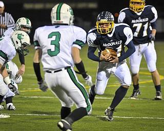 McDonal's Zach Tura looks for an opening against Mogadore during their Div VI playoff game at Twinsburg on Friday night. Photo/Mark Stahl