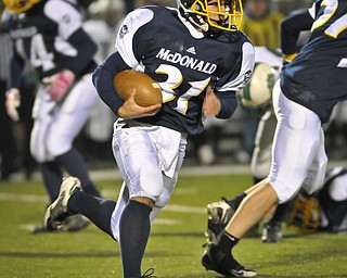 McDonals Zach Tura runds the ball against Mogadore during their Div VI playoff game at Twinsburg on Friday night. Photo/Mark Stahl
