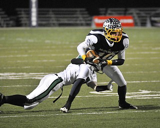 McDonald's Justin Rota looks for extra rads after a pass reception against Mogadore during their Div VI playoff game at Twinsburg on Friday night. Photo/Mark Stahl