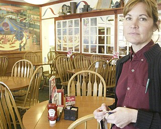 William D Lewis the Vindicator  Friendly's in Poland was closed because of a boil water alert Friday. Restuarant supervisor Kathy fox stands in an empty dining room Friday.