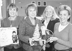 William D. Lewis | The Vindicator: Kids' Crew committee members preparing for two holiday events to benefit Akron Children's Hospital Mahoning Valley are, from left, Julie Costas, Donna Hayat, JoAnn Stock and Kathy Dwinnells.