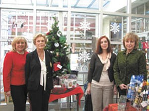 Looking forward to greeting guests at the 40th Annual American Holiday Fine Arts and Crafts Show and Sale at The Butler Institute of American Art are, from left, committee members Helen Paes and Julia Hoover; Renée Sheakoski, museum gift show manager; and Pat Almasy, gift shop volunteer.
