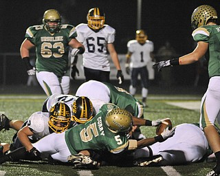 Ursuline's Jesse Curry reaches the ball over the goal line for an early 2nd half TD against Kirtland during their game in Auora on Saturday night. Photo/Mark Stahl