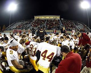 NOVEMBER 20 - RAVENNA-OHIO:  The Cardinal Mooney Cardinals pray before taking on the Akron Buchtel Griffs at Ravenna High School on November 20, 2010.  (photo by:  Justin K. Aller)