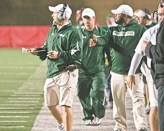 While Ursuline coach Dan Reardon, left, spends Saturday nights in the spotlight, he and his staff spend the bulk of their efforts on the days leading up to each playoff game.