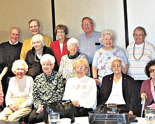 Golden olden days: Recollections of their golden days growing up in Niles were shared by members of Niles McKinley High School Class of 1943 during a luncheon Nov. 9 at Ciminero's Banquet Centre in Niles. They learned who drove the first cars to school and who ran home for lunch each day. Also discussed were ways in which the world has changed since their school days. Class members have met three times a year for the past 17 years and have kept in touch through their class newsletter. Sharing the nostalgic walk down memory lane are, seated from left, Earlene Negro, Martha Jensen, Lena Fately, Evelyn Blatchford, Mable Pascarzi and Alice Helwig; and standing, Gary Naeser, Norma Jean Parke, Bill Brownlee, Dr. Douglas Evans, Ruth Naeser, Verna Brownlee, Georgia Jones, George John, Mary Ann Luich, Leona Miller, Filomena Donadio, Robert Stoll and Siromani Stoll.
