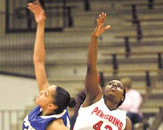 YSU's Brandi Brown and IPFW's Stephanie Rosado go for the ball during Saturday action at YSU.
