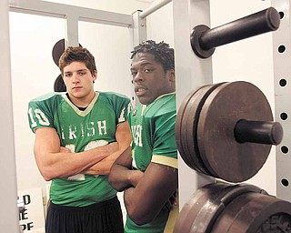 READY FOR THE SACK -  State honored  Jordan Markota and Keil'n Thurston play together and practice together  as Ursuline makes its run for a state championship title.